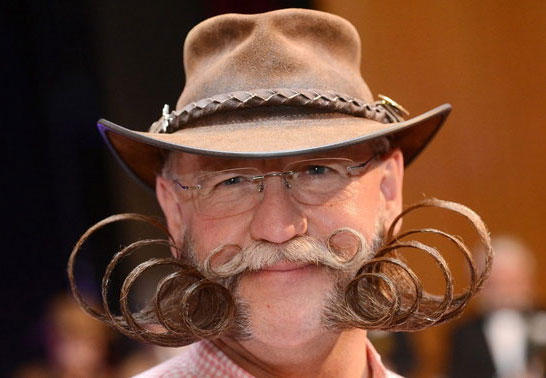 Photo of man at moustache and beard championship