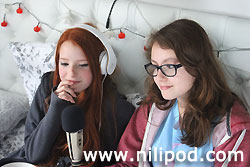 Girls with headphones doing podcast video