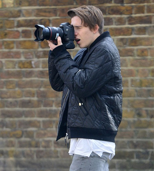 Brooklyn Beckham being a photographer at the Burberry fashion shoot