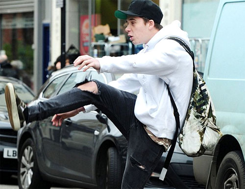Brooklyn Beckham showing of his soccer skills, kicking a coin