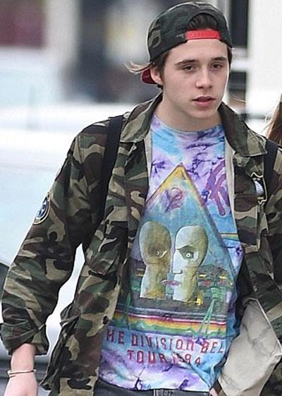 Photo of Brooklyn Beckham with a trendy tye died Pink Floyd T-shirt