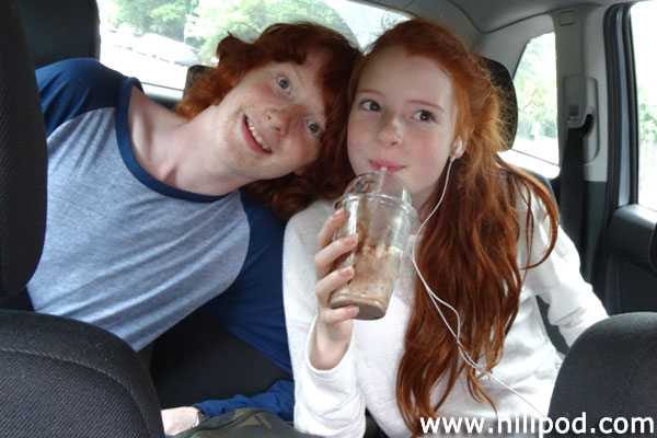 Photo of brother and sister in back of car
