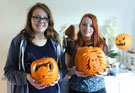 Photo of girls with carved pumpkin lanterns