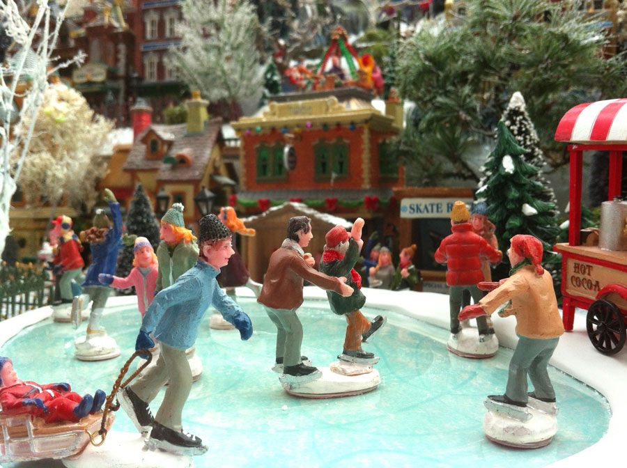 Image of Christmas Village ice skaters in winter