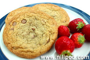 Image of freshly baked chocolate chip cookies with strawberries