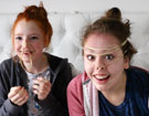Photo of girls playing elastic band face game