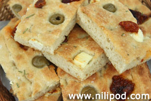 Further photo of focaccia bread, topped with feta cheese and olives