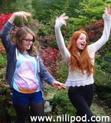 Girls striking a pose in the garden