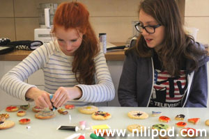 Decorating the biscuits with coloured icing