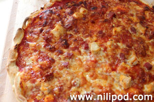 Image of a cheesy homemade pizza with mozzarella cheese