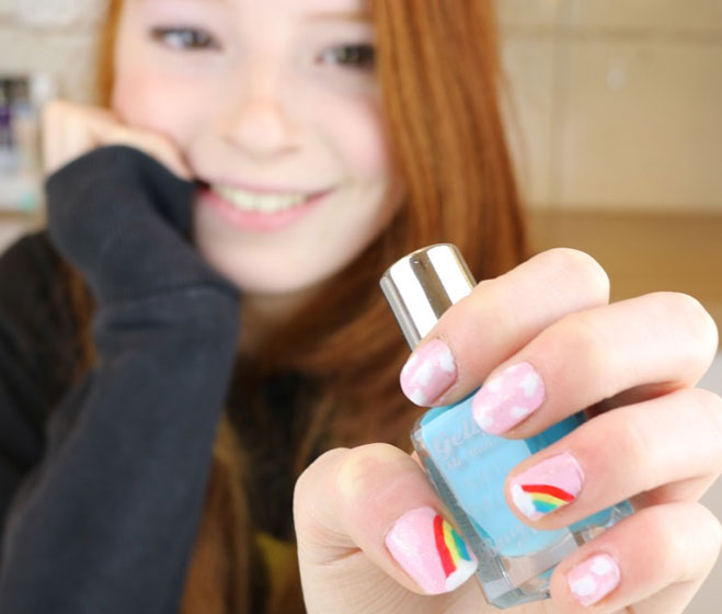 Photo of girl with rainbow nail polish designs