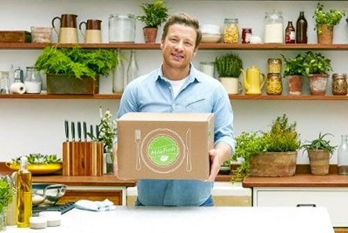 Picture of Jamie Oliver holding HelloFresh box