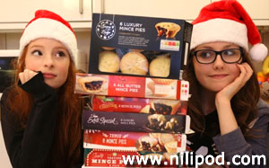 Photo of girls with boxes of mince pies
