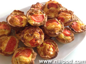 Image of some homemade quiches on buffet plate