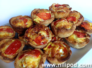 Further picture of homemade mini quiches on a white plate