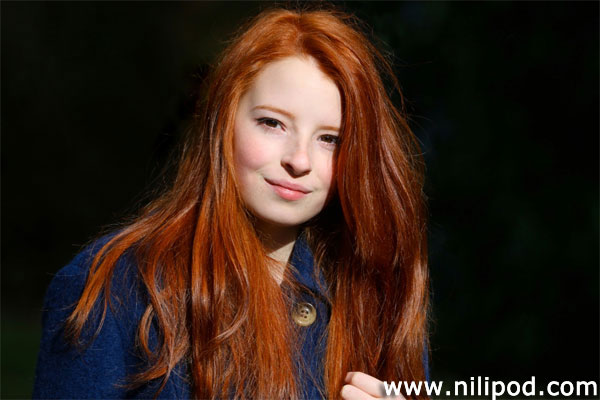 Portrait image of girl with red hair