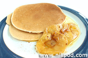 Photo of breakfast pancakes with apple slices