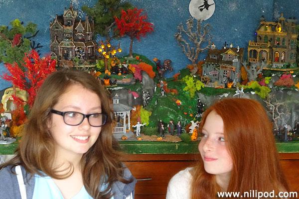 Posing in front of Nia's model Halloween village
