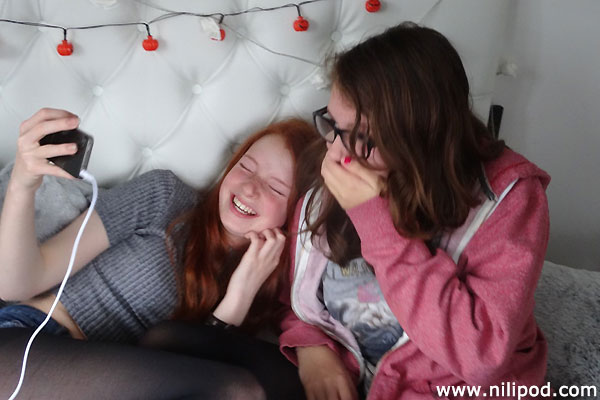 Laughing while looking at a funny video on the iPhone