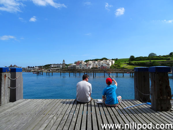 Photo of father and son fishing at Swanage