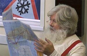 Photo of Santa Claus reading newspaper