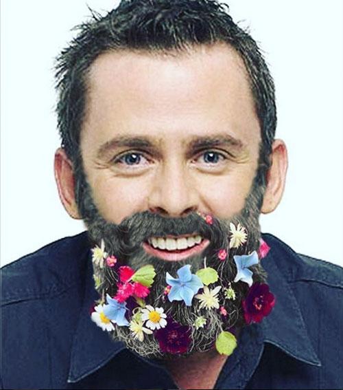Image of Scott Mills with flowers in beard