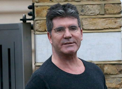 Image of Simon Cowell outside his house, after buglary