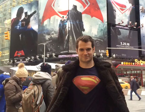 Image of Henry Cavill posing as Superman in New York Times Square