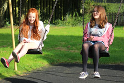 Girls on swings at playground