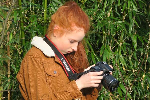 Photo of girl using Canon EOS 70D camera
