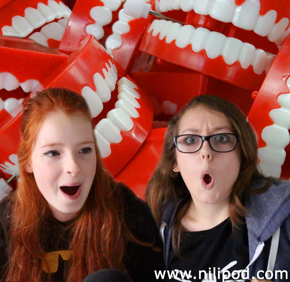 Photo of girls with toy teeth from joke shop