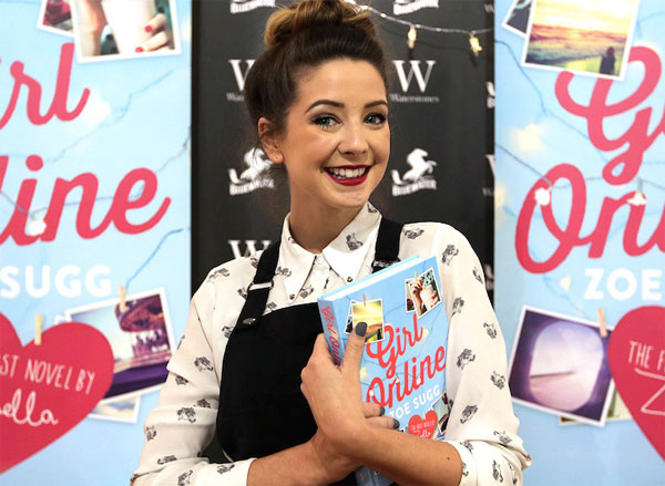 Photograph of Zoella holding up her book Girl Online